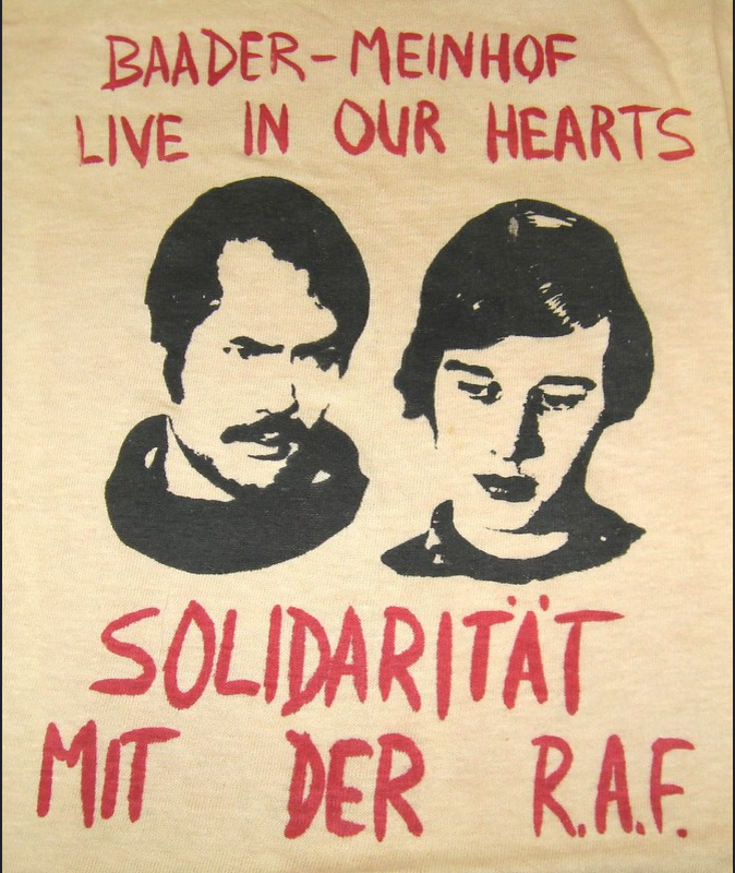 "Depicting the faces of Andreas Baader and Ulrike Meinhof, this T-shirt shows support for the Red Army Faction (RAF), or Baader-Meinhof Gang – a militant leftwing terror group formed in 1970, West Germany; they fought for communism, anti-imperialism, and used violent means to promote their political goals and beliefs. Translated from German, the bottom portion of the shirt states: ""Solidarity with the R.A.F."""
